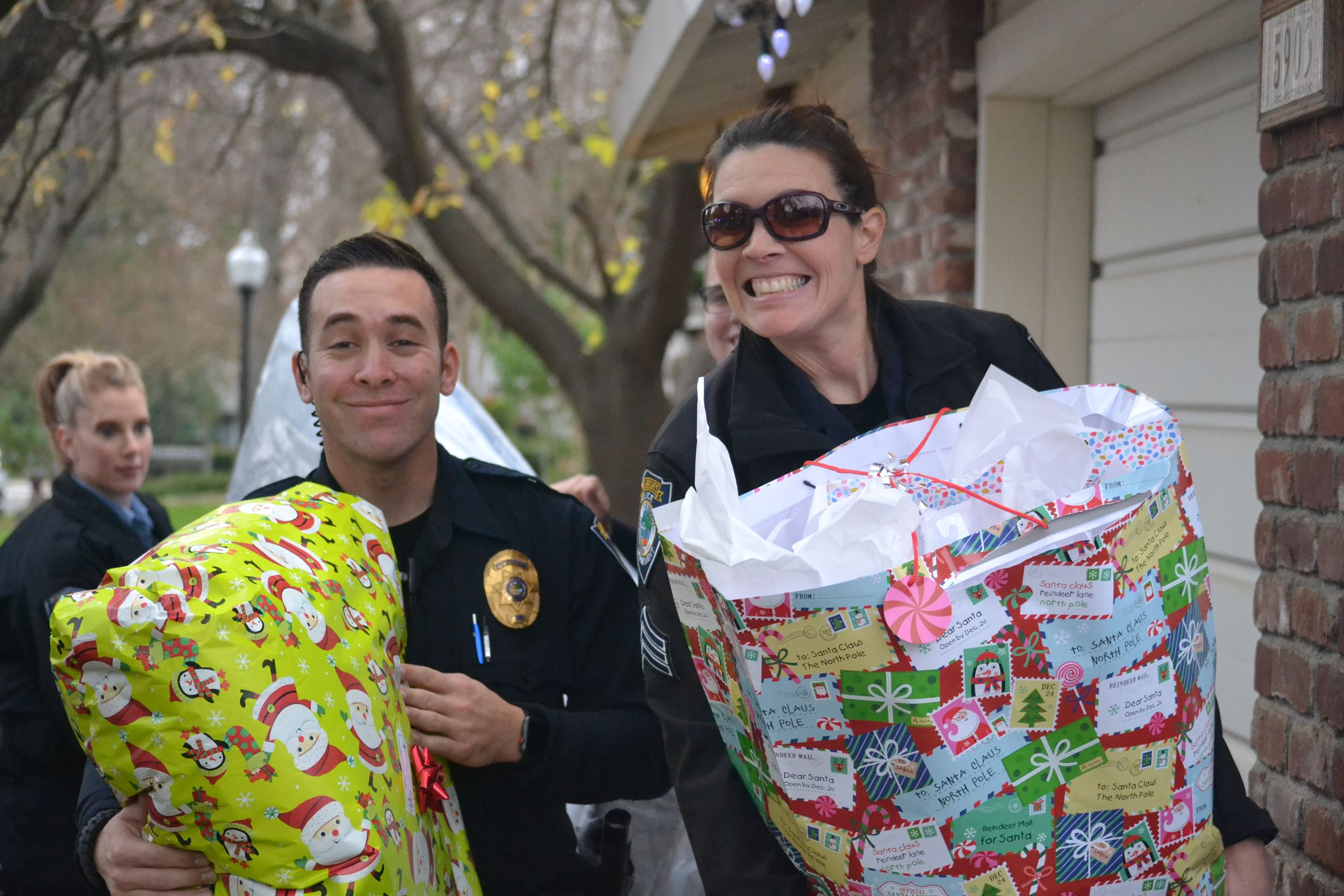 Police personnel delivering gifts