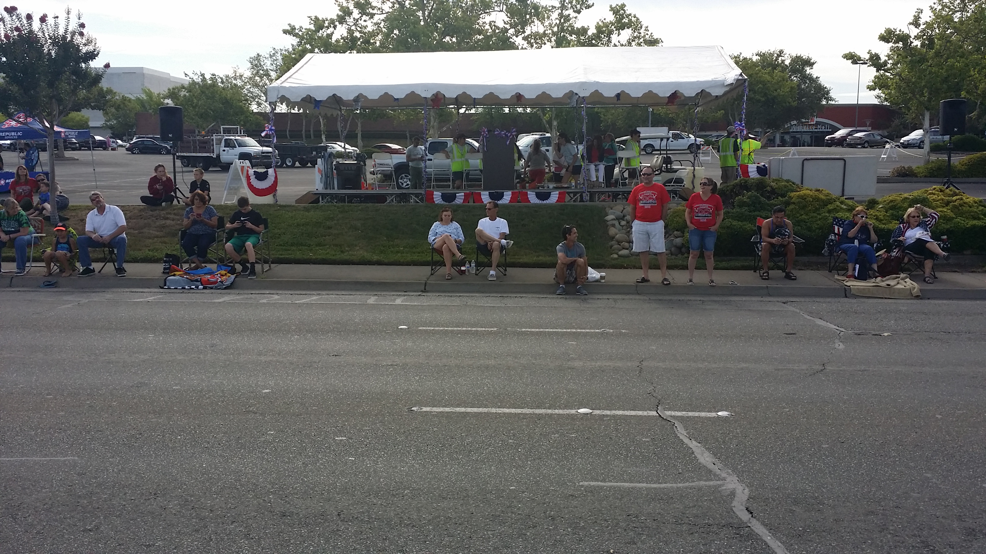 Neighbors gather at the parade grandstand