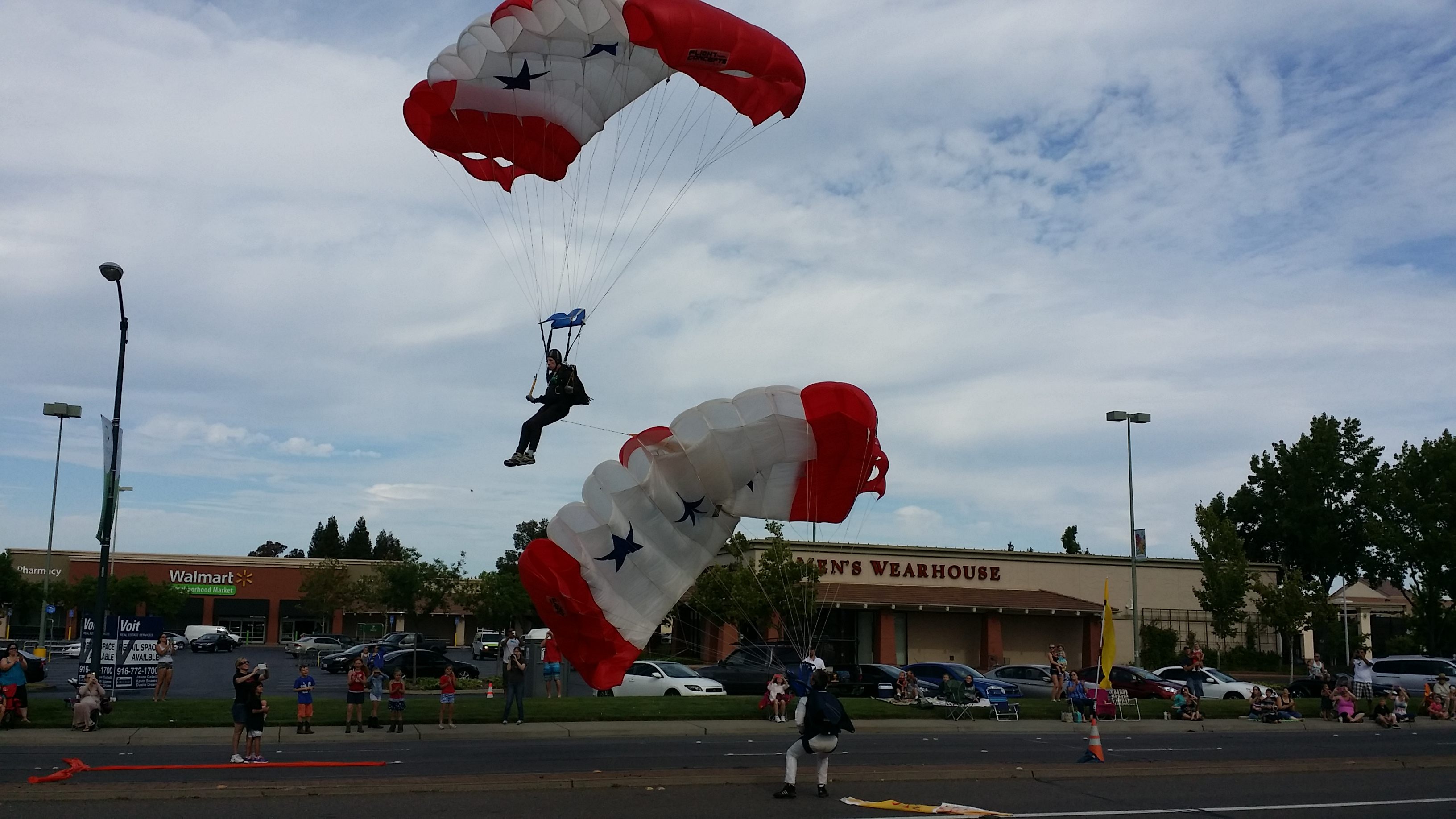 Skydivers as they land in front of Sunrise Mall
