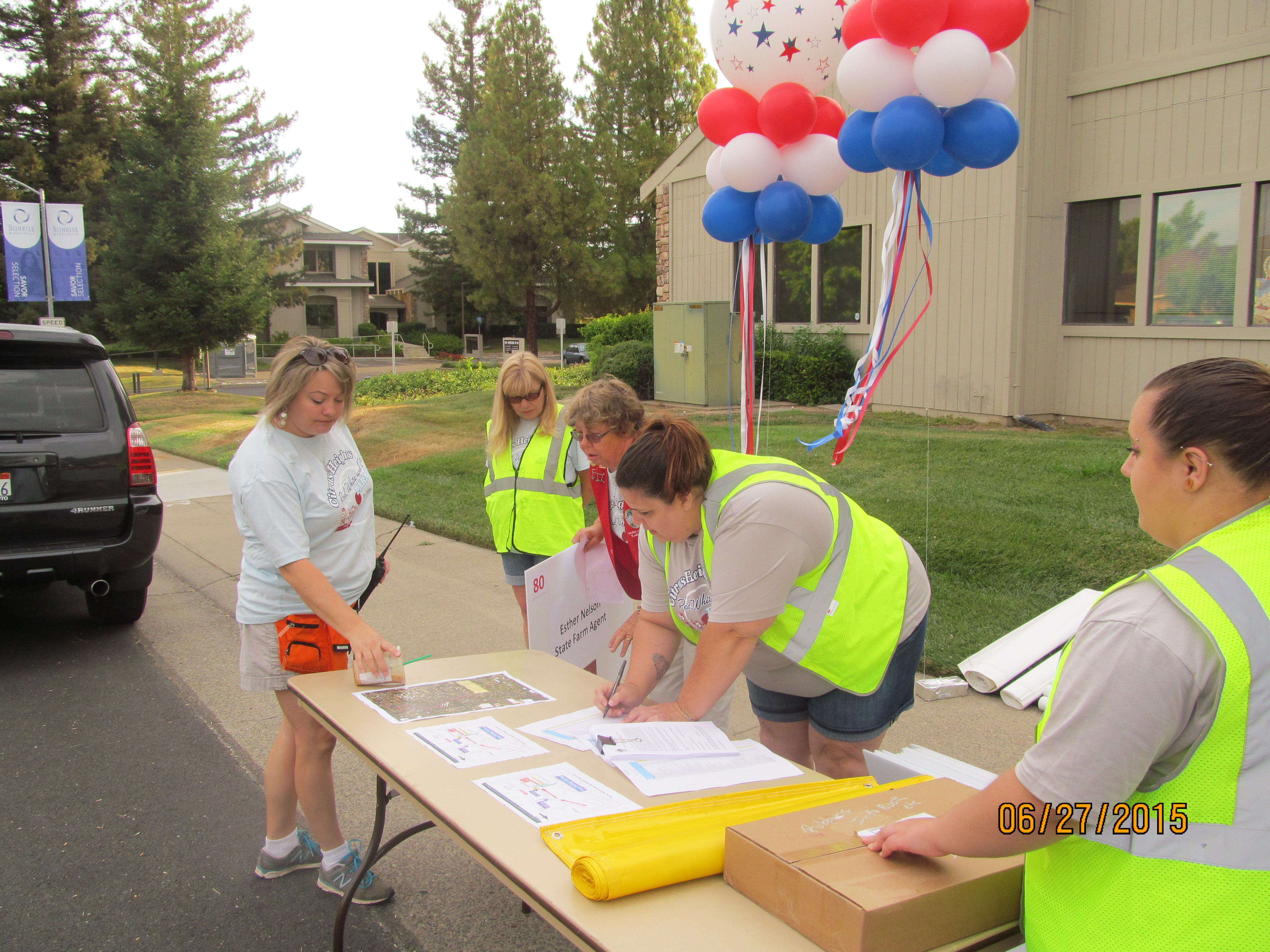 Volunteers checking in parade participants